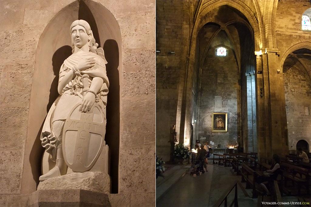A gauche, statue de Saint Victor, sculptée par Richard van Rhijn, né en 1957. A droite, église haute.