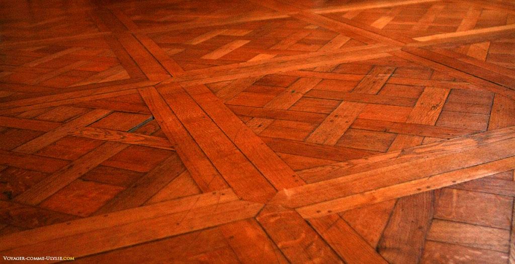 Assoalho de tacos de madeira de Versalhes.