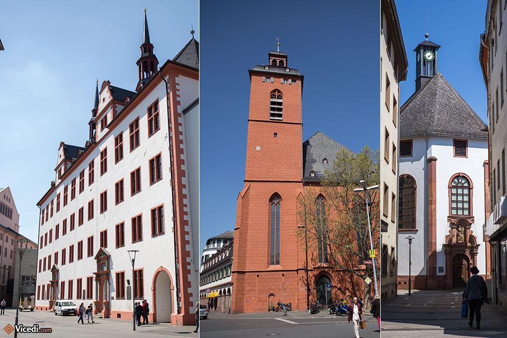 A gauche, les bâtiments de l'ancienne université de Mayence. Ils hébergent aujourd'hui l'Institut Leibnitz de l'Histoire Européenne. Au centre, l'église Saint Quentin. A droite, la chapelle Saint Joseph.